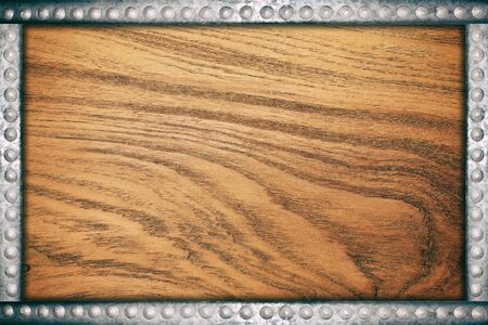 rivets: Wood plate background with metal rivets frame