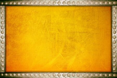 Scratches on a metallic gold background with metal rivets frame