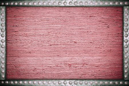 nameboard: Old red fabric background with metal rivets frame Stock Photo