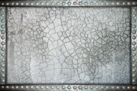 rivets: cracked wall background with metal rivets frame