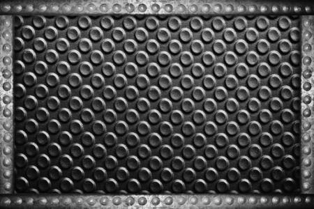 rivets: black plastic background with metal rivets frame