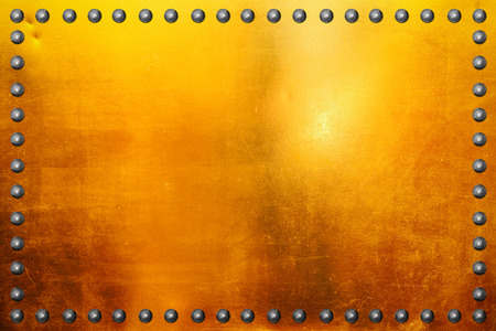 rivet metal: Gold polished metal plate texture with rivet. Stock Photo