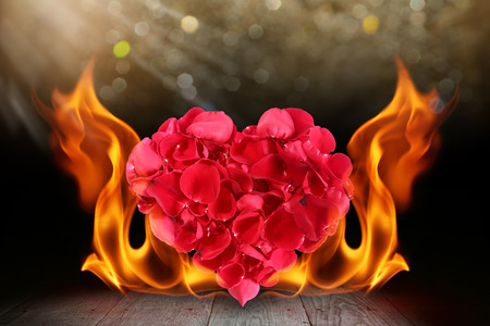 Rose petals heart shape with blaze fire flame on wooden deck
