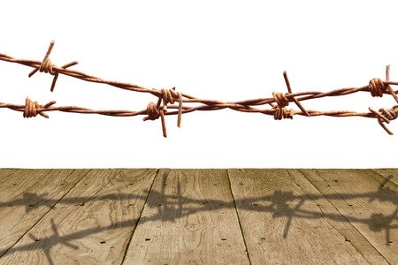 Old wooden panel and rusty barbed wire isolated on white background.