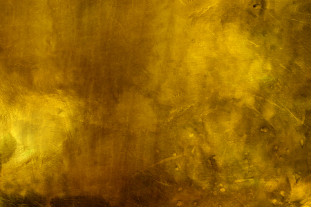 old dark gold texture background with scratches