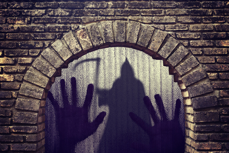 Silhouette of a hand the expression to be imprisoned ghost shadow standing in tunnel