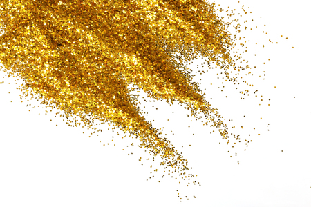 Golden glitter sand texture handful spread on white, abstract background with copy space. Stockfoto