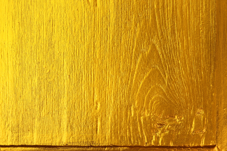 Gold paint on wooden panel for background