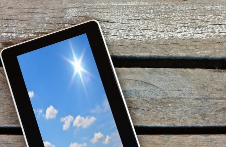 tablet on wood background photo
