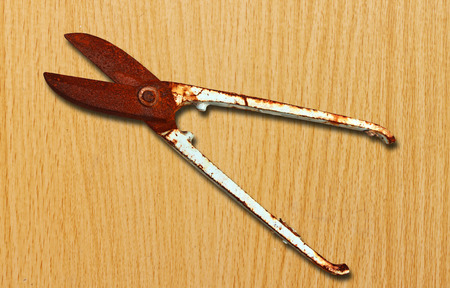 snips: Old scissors on wooden background Stock Photo