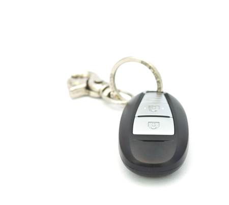 Car key with remote control on white background photo