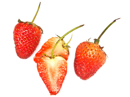 half stuff: A heap of fresh strawberries on white background  Isolated Stock Photo