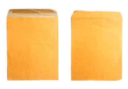 Brown envelope isolated on white background photo