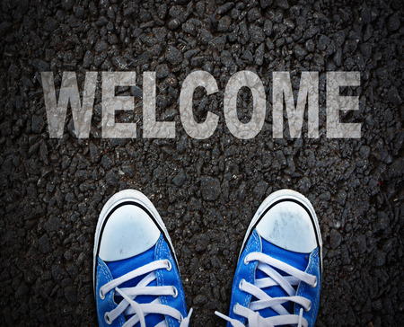 welcome sign: Pair of shoes standing on walkway Stock Photo