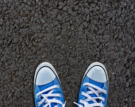 homecoming: Pair of shoes standing on walkway Stock Photo