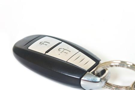 remote control over white background photo