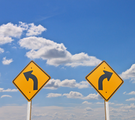 Direction sign- right turn warning on blue sky background photo