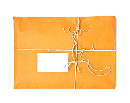 pack string: Parcel tied with string with address label attached Stock Photo