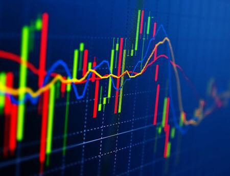 Van de de grafiekbar van de beurs de maankwabcemacro close-up. Achtergrond met voorraaddiagram op monitor.