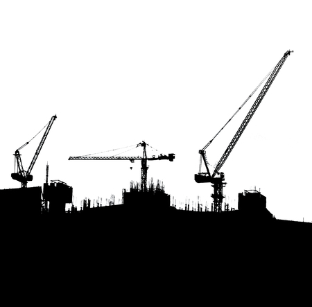Silhouettes of crane on building photo
