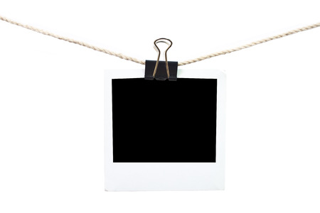 Blank photo hanging on a piece of string