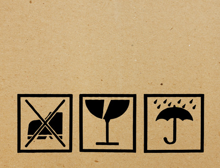 Safety, fragile icons on a cardboard parcel with copy space photo