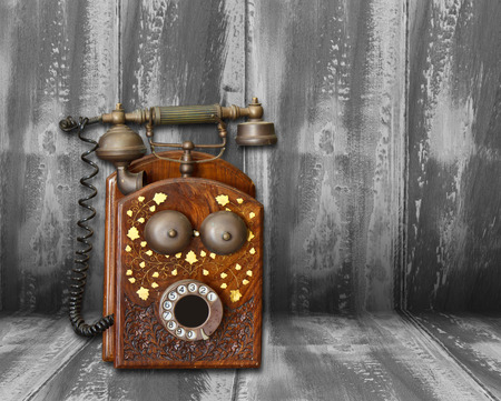 old phone on wood still life style photo