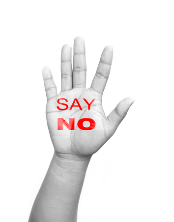 Open hand raised Say No sign painted  isolated on white background