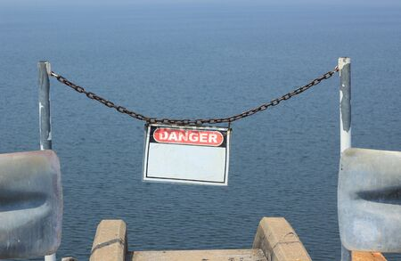 no swimming sign: Danger no swimming sign in sea Stock Photo