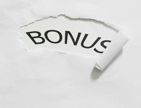 paper hole: bonus word write on paper hole Stock Photo