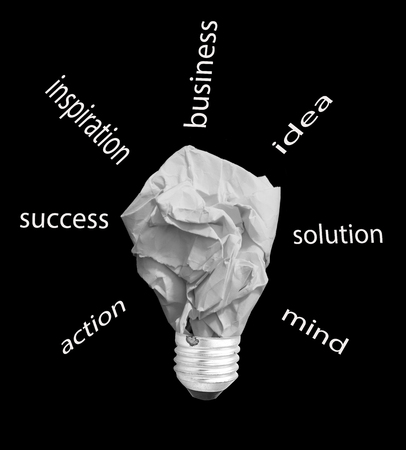 crumpled paper: concept crumpled paper light bulb metaphor for good idea on black background
