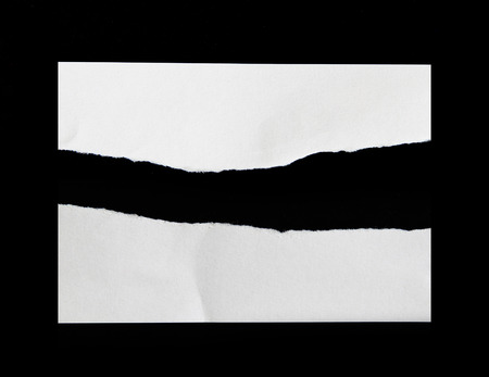 photo paper: Torn pieces of paper on black background