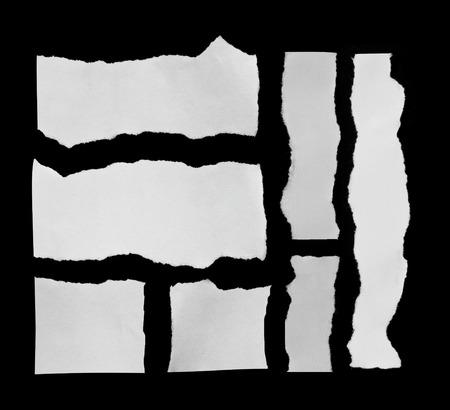黒に破れた紙の 写真素材