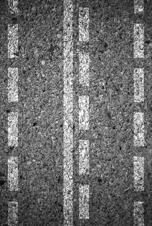 markings: Lines and lane markings on the on asphalt road surface texture