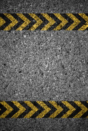 yellow line: Asphalt background with black and yellow markings