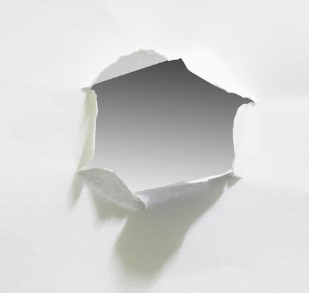 Hole in the paper sheet, clipping path. Reklamní fotografie