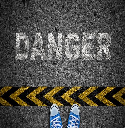 danger: Caution tape over asphalt background, Warning sign, Danger sign.