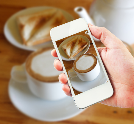 take a break: take a break, taking photo of latte the with mobile phone