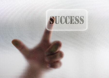 Human finger push SUCCESS button Stock Photo