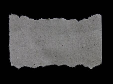 torn edge: Torn pieces of paper on black background