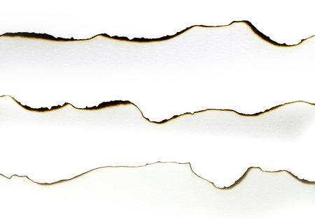 burned paper: Burned paper edges set isolated on white