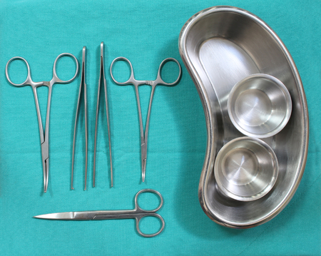 medium group of object: set of surgical instrument on sterile table