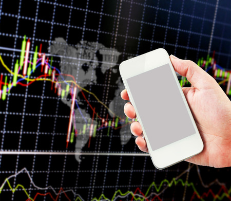 stockbroker: Hand holding cellphone with stock exchange screen.Forex.