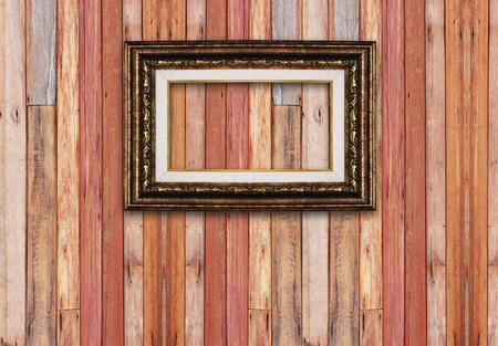 gold picture frame: Picture frame isolated on wood background