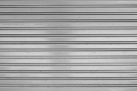 metal wall: close-up detail of closed metal security shutter Stock Photo