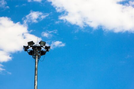 Light post isolated on a blue sky background.