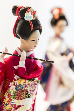 Japanese doll dressed up by kimono.