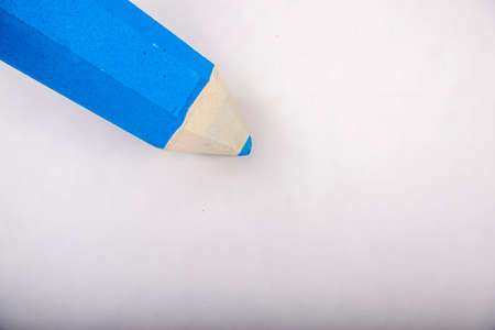 Blue pencil stands on a white background