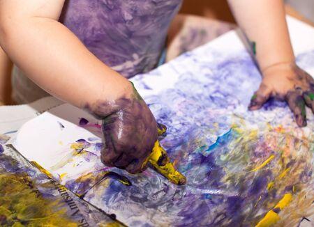 Little Children Hands doing Fingerpainting with vaus colors Stock Photo - 5519257
