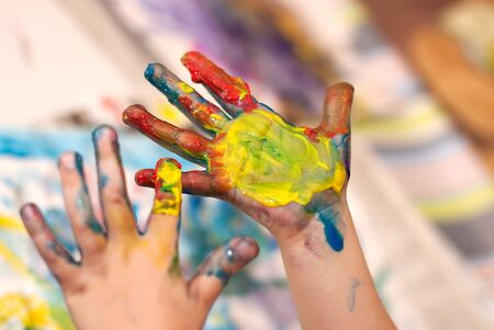 Little Children Hands doing Fingerpainting with various colors Stock Photo - 5519260